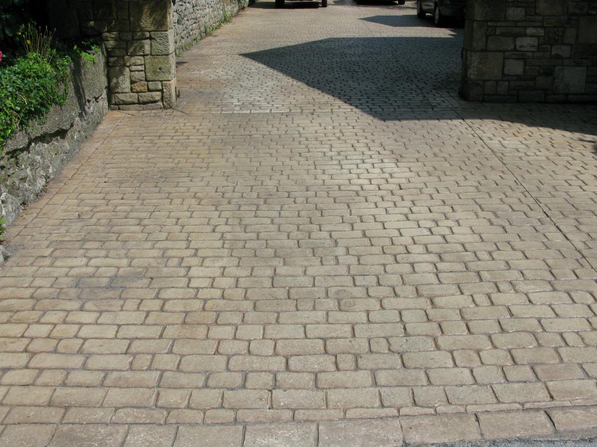 Paving stone styled stemped concrete driveway with cobbled edges for a Lancaster property.