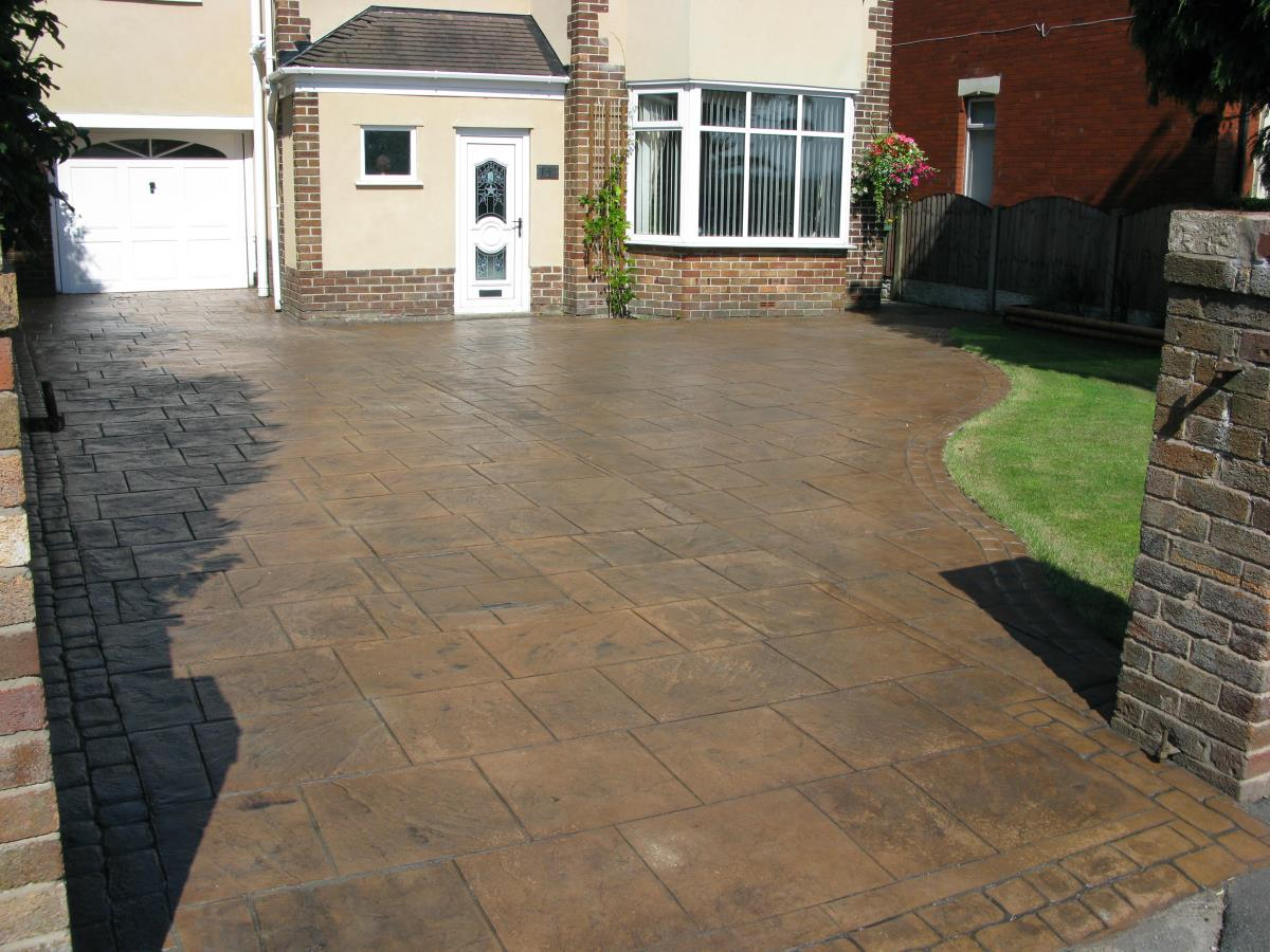 Decorative concrete driveway in toffee coloured walkway slate with a satin finish at a property in Warrington.
