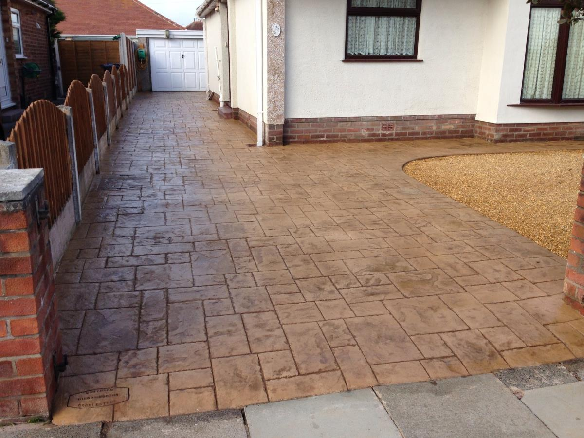 Ashlar slate style stamped concrete driveway in light buff installed to a Lancashire bungalow.