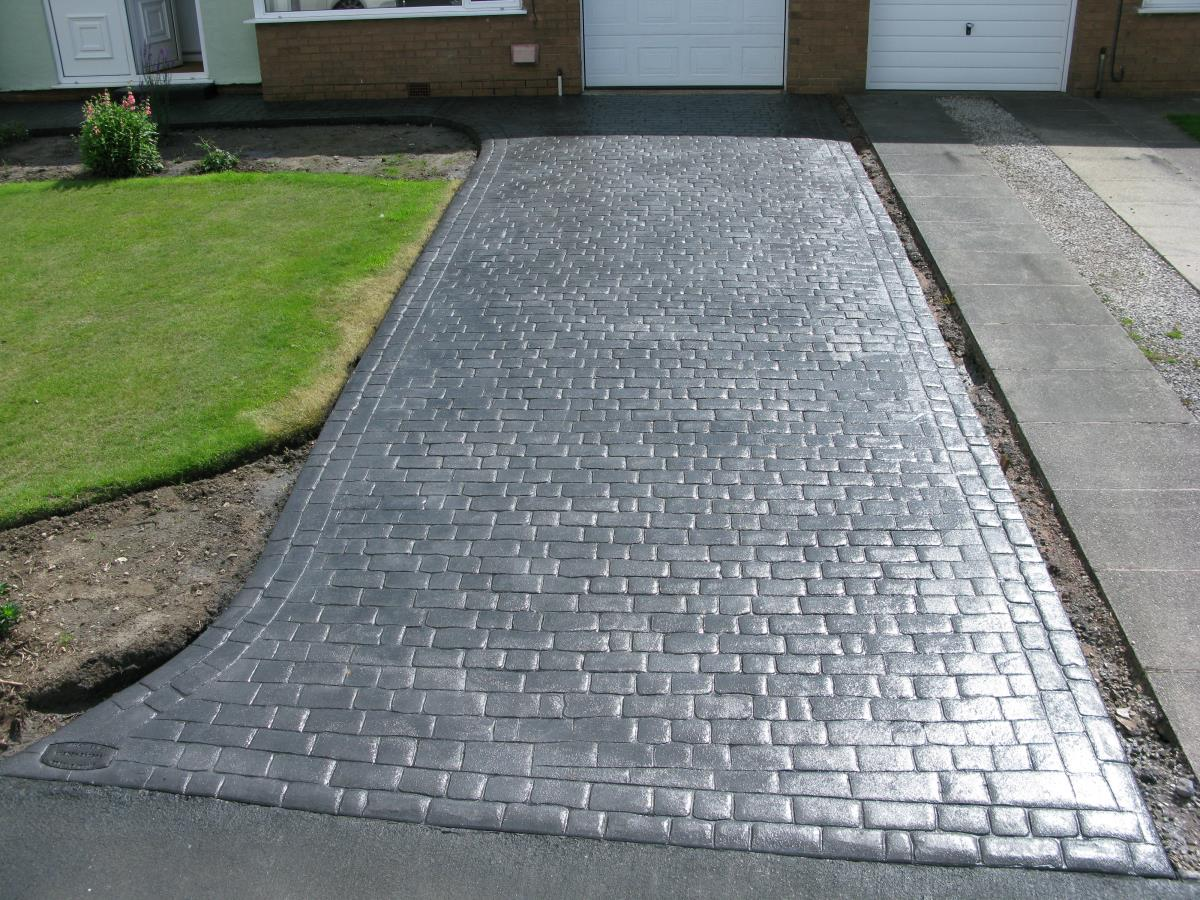 Mews cobblestone effect stamped concrete driveway installed for a Over Wyre customer.