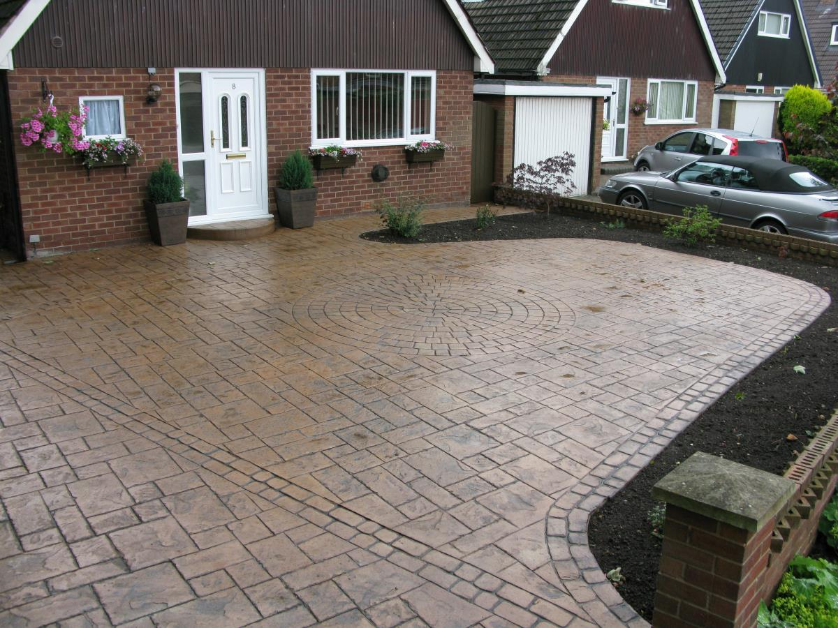 Styled concrete driveway in light buff ashlar slate for a Stockport household