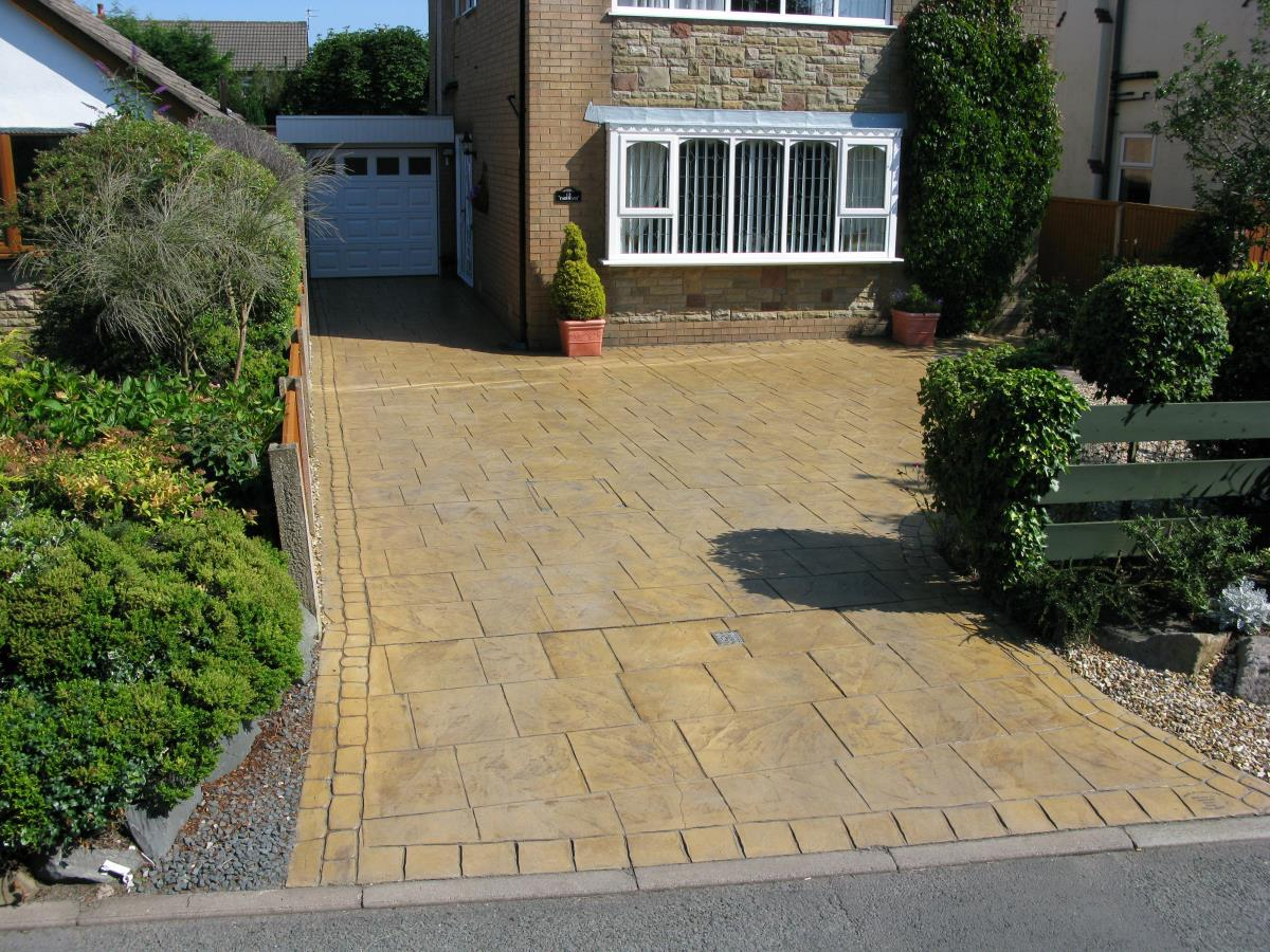 Pattern imprinted concrete driveway finished in golden beige walkway slate style for a Over Wyre customer.