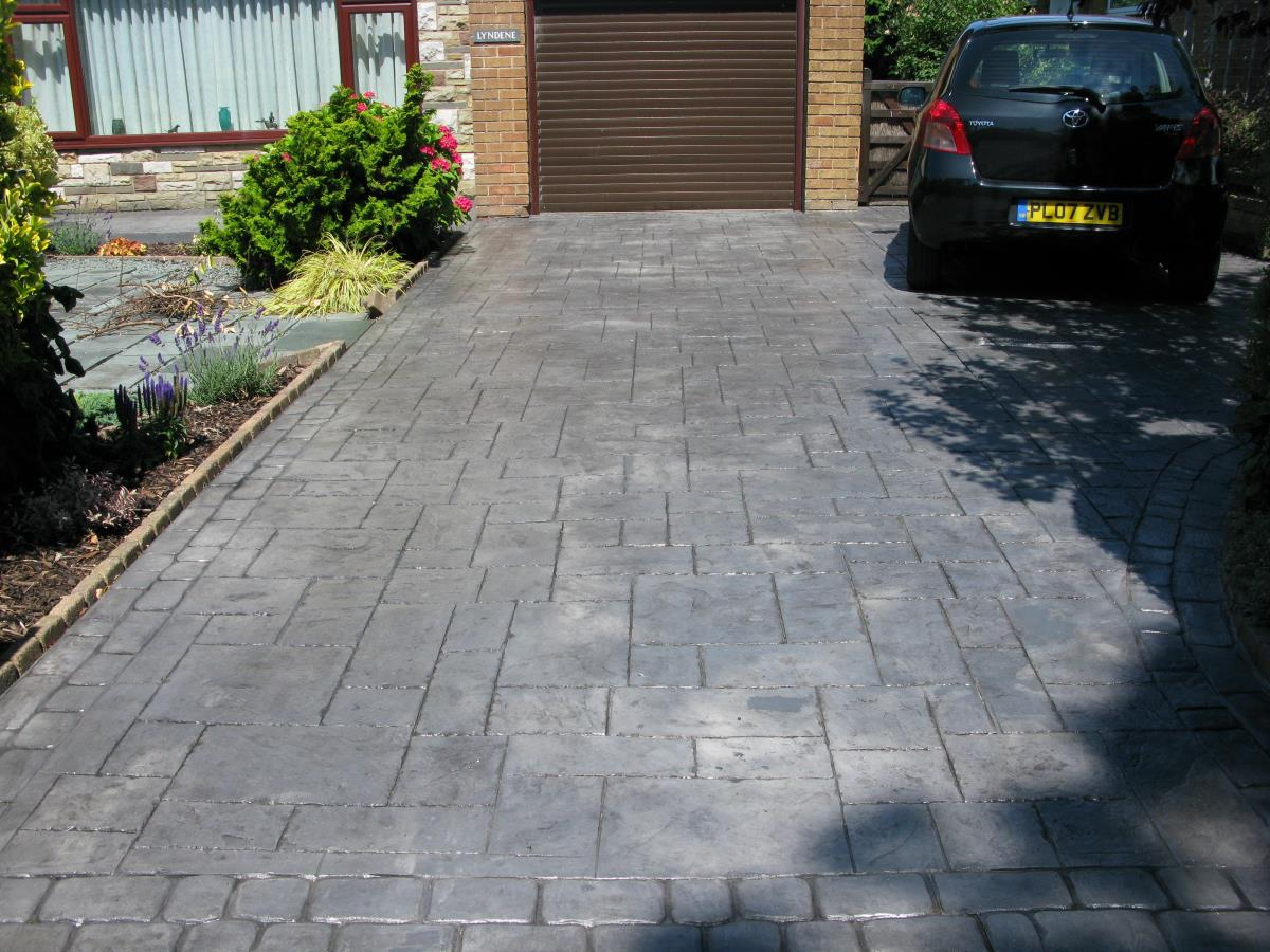 Patterned concrete in a silver grey ashlar slate style installed to Lytham St Annes driveway.