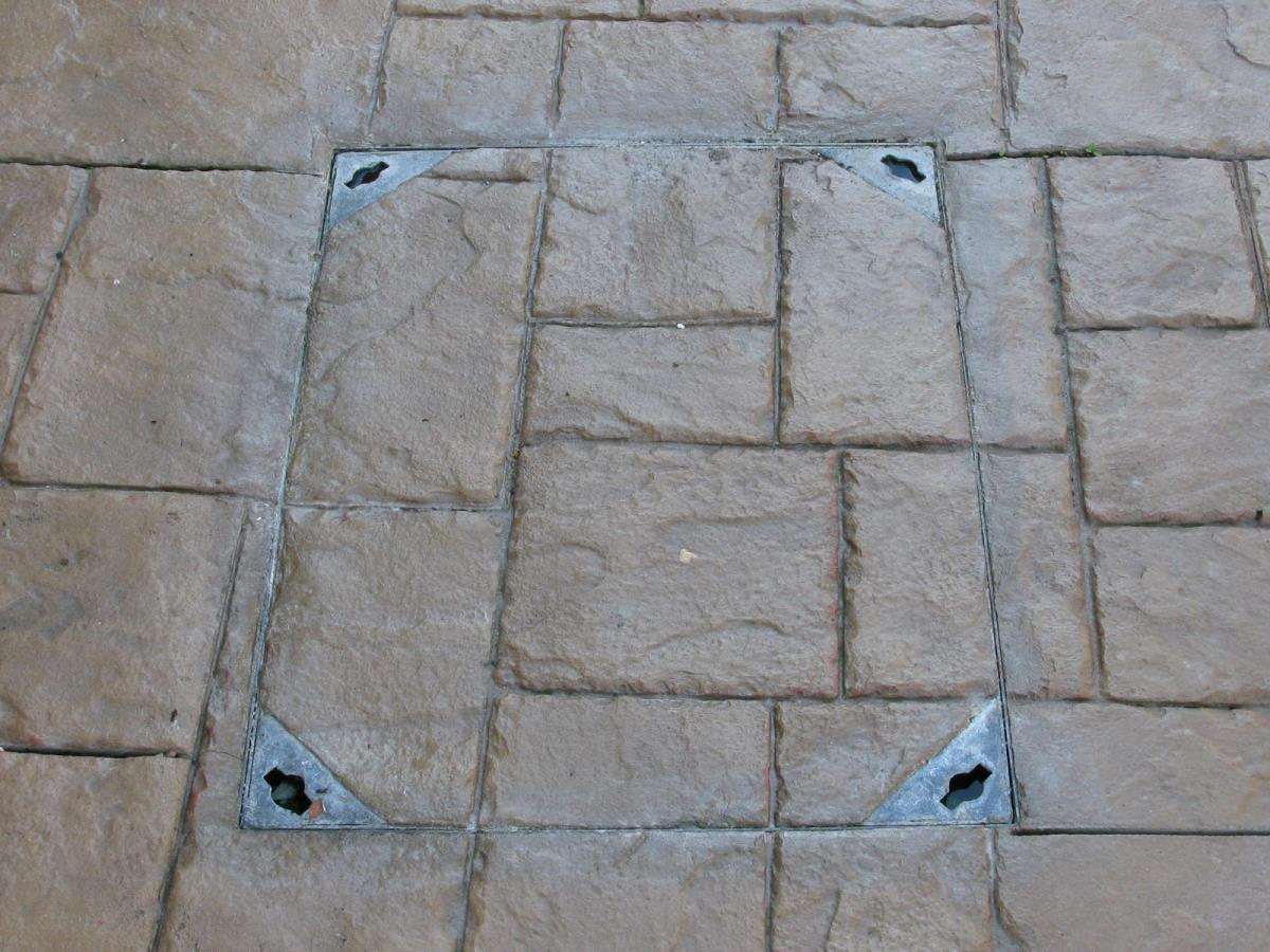Drainage and other features can be blended in as per this recessed tray heavy duty manhole cover on a driveway in Caton, near Lancaster