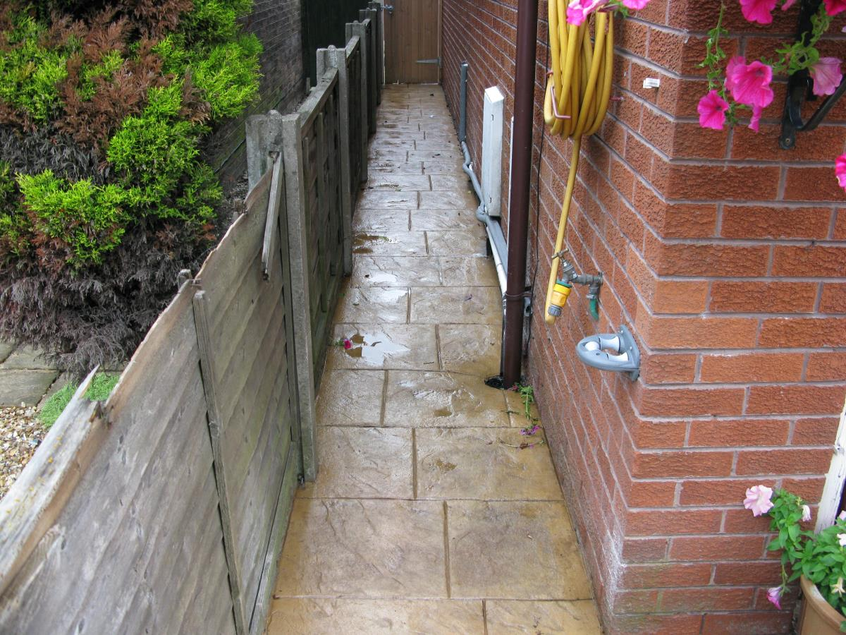 Path at side of Preston home shows if you can comfortably walk, we can pattern imprint.