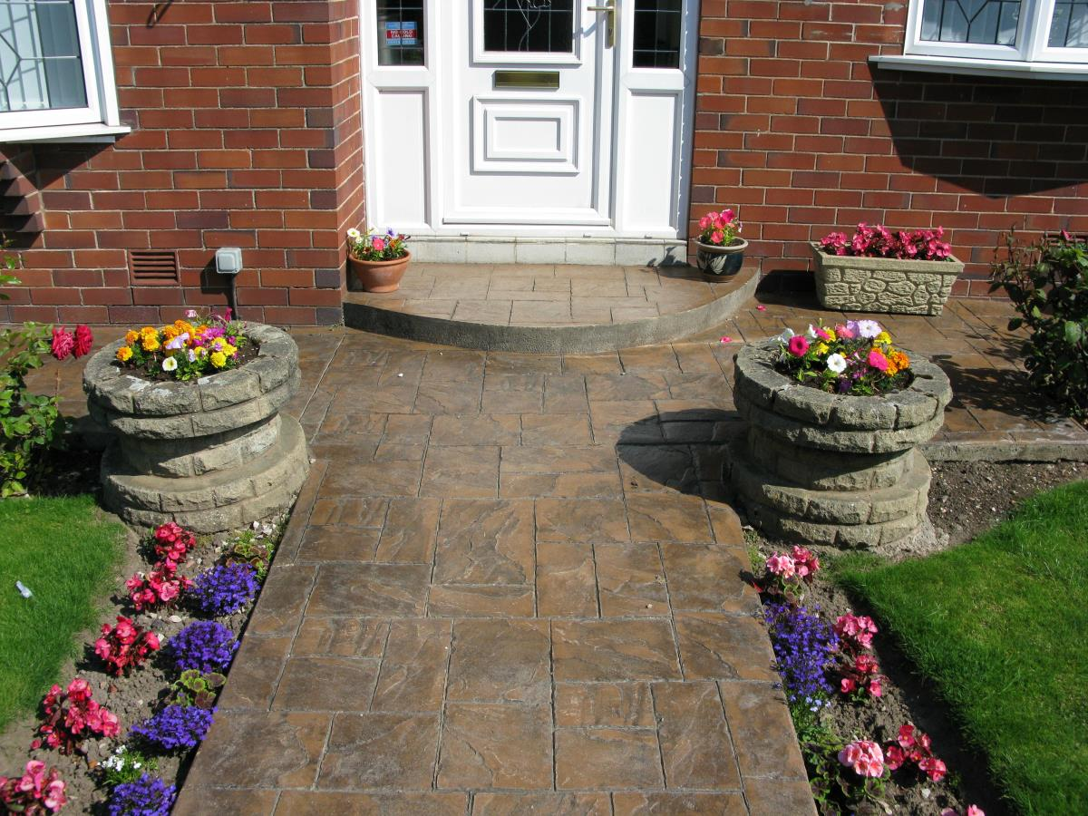 Pattern imprinted concrete path and quadrant step in toffee coloured ashlar slate style installed to a garden in North West.