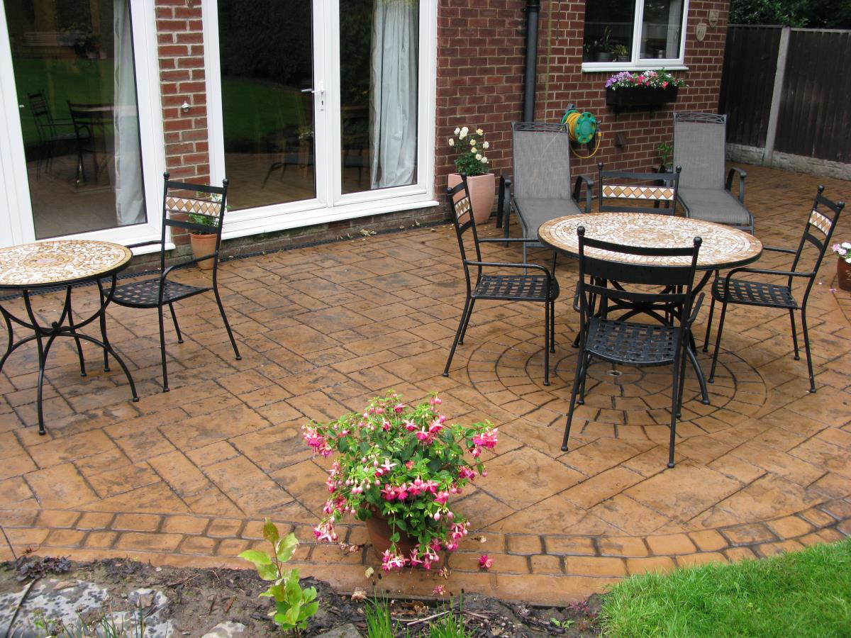An example in Garstang of turning a small unusable area into an attractive patio space for summer BBQs, etc..